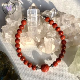 Gold Goldstone Bracelet with Faceted feature bead